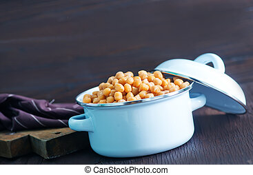 chickpeas in metal bowl and on a table