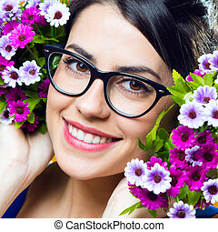 Happy young girl with flowers