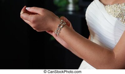 Bride in wedding dresses bracelet on the arm