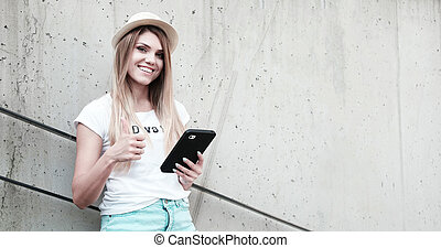 girl with thumbs up using a tablet