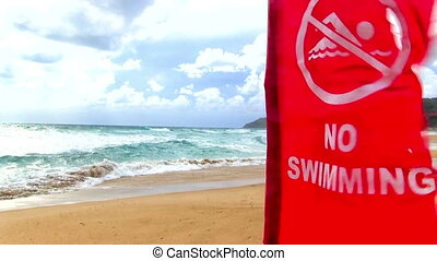 red flag quot;no swimmingquot; - tropical beach with red...