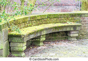 Bench of stone - Old antique bench in stone in an old park