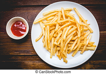Golden French fries potatoes & Ketchup ready to be eaten
