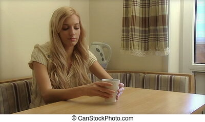 Woman Drinks Coffee - Young beauty woman drinks coffee in...