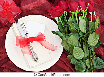 Valentines Dinner - Romantic table setting with gift and a...