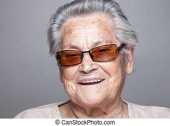 Portrait of an elderly woman with glasses - Closeup portrait...