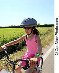 eight year old girl goes to bike with helmet - eight year...