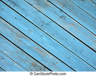 Old wooden boards, located on a diagonal with a shabby blue...