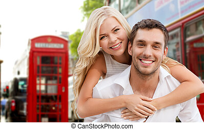 happy couple hugging over london city street - summer...
