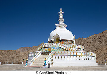 Shanti Stupa is a Buddhist white domed stupa in Leh, India -...