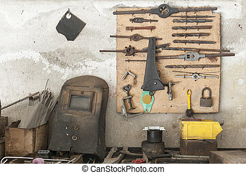workbench - old workbench with old work tools hanging on...