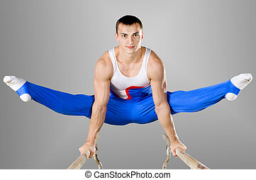 gymnast - The sportsman the guy, carries out difficult...