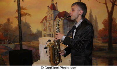 enjoying saxophone  - medium shot of enjoying saxophone