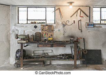 workbench - old workbench with old work tools in home garage
