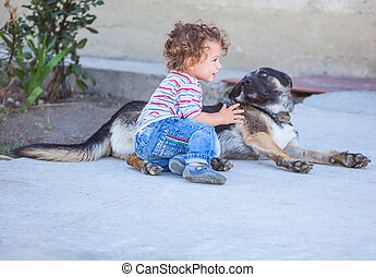 Baby boy playing with a dog - Portrait of 1 year old baby...