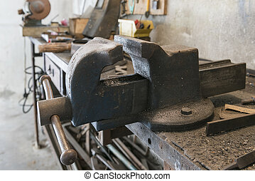 bench vise - old bench vise with old work tools in home...