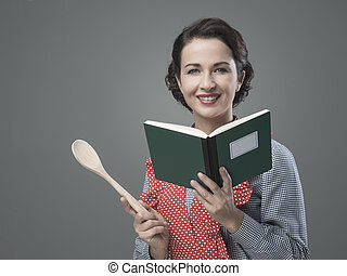 Vintage woman with cookbook