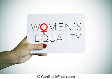 woman holds a signboard with the text womens equality - the...