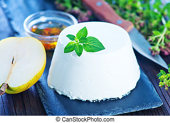 ricotta cheese with fresh pear on a table