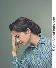 Vintage woman with headache touching her forehead
