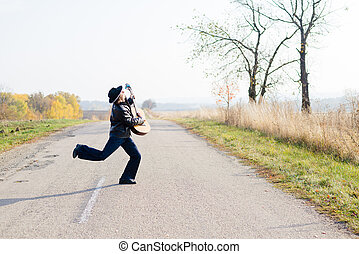 Picture of excited giutarist playing guitar crazy crossing...