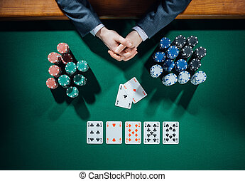 Poker player with cards and chips