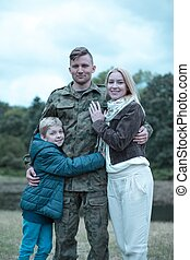 Soldier and happy family