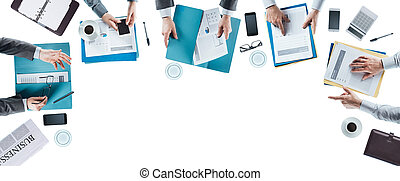 Business team meeting and working at office desk, hands top...