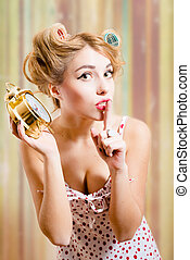 Blond woman with haircurlers dotted langerie holding...