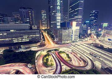 Illuminated traffic loops outside Shinjuku Station,...