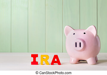 IRA theme with wood block letters and piggy bank -...