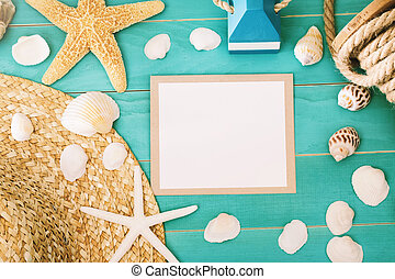 Blank message card with sea shells and straw hat on light...