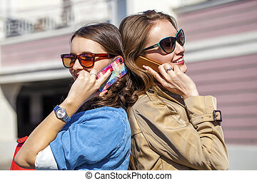 Two Young Women with Mobile Phone