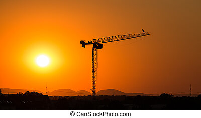 Tower crane in the sunset - Huge tower crane silhouette shot...