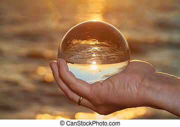 crystal ball - The sun sets over Lake Constance in Germany...