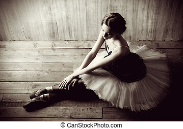 exhaustion - Professional ballet dancer resting after the...
