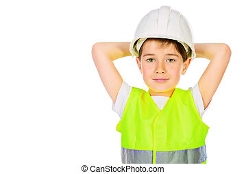workwear - Cute boy in a costume of a builder posing with...