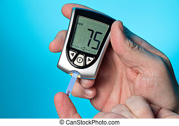Blood glucose meter to check the blood sugar level - Glucose...