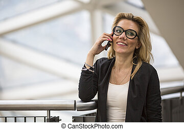 woman talking on cell phone - Attractive young blond woman...