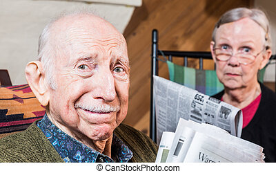 Elderly Man and Woman with Newspaper - Elderly man and woman...