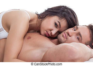 Lovers during gentle embrace posing at camera