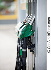 Pump nozzles at the gas station, shallow depth of field with...