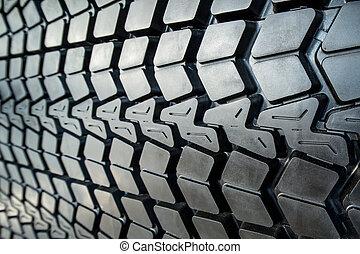 Textured tire tread - Photo coarse textured black tire tread...