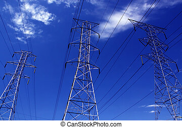 power lines stand tall with blue sky
