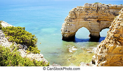 Rock cliff arches on Marinha beach ,Portugal
