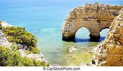 Rock cliff arches on Marinha beach ,Portugal