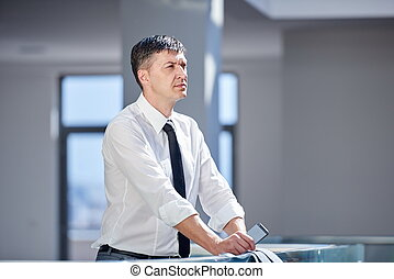 business man using phone at modern office space