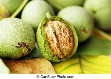 Green walnut, peeled and leaves