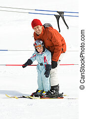 Family skiing - Father with his daughter in the ski lift