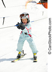 Girl in ski lift - Little girl with ski suit in the ski lift...